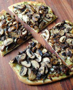 Not a vegan recipe but inspiration for a delicious vegan pizza idea - naan bread, vegan pesto and sauteed mushrooms=vegan mushroom pesto pizza!!