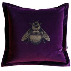 Napoleon Bee Cushion from Timorous Beasties.    Wonderfully surreal and provocative designs from Timorous Beasties. The Scottish design studio have defined an iconoclastic style often described as 'William Morris on Acid'. Napoleon Bee hand printed in black and gold onto honey British velvet. Comes complete with full feather core.    Dimensions: 65cm x 65cm