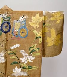 detail of Nuihaku (Nō costume)—design of lily and court-cow-carriage patterns on brown fabric, Momoyama period/16th century  Tokyo National Museum. This is a kimono made of a fabric called nerinuki featuring the luster of silk and a firm texture, the entire surface of which is covered with embroidery. Since the patterns are created using embroidery and gold leaf, this is called nuihaku....this Noh costume might have been worn in Noh performances played before the Toyotomi clan.