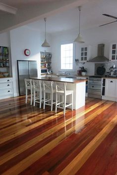Recycled Australian hardwood timber mixed colour flooring, benchtops, kitchen island.