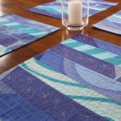Decorate your table with four placemats in a refreshing, contemporary mix of Marimekko blues with a splash of dark cyan. Machine quilted rows create interesting pattern and texture on these beautiful prints. The fabric on the back is Marimekko Kivet in two shades of blue.