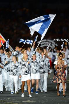 Hanna-Maria Seppala of the Finnish Olympic swimming team carries her country's flag during the Opening Ceremony of the London 2012 Olympic Games at the Olympic Stadium on July 27 2012 in London England. Finland Flag, Olympic Swimming, North Europe, Commonwealth Games, Girls World, Summer Olympics, My Heritage, Track And Field, Opening Ceremony