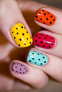 I like the dots, but i'd rather have different colors than these. not my personal style. It would be cute with nude on all 4 fingers except the ring finger, maybe neon yellow or neon pink on the ring finger.
