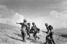 A U.S. Marine sergeant points directions to a group of newly arrived replacement soldiers atop embattled Hill 881, below the demilitarized zone near the Laotian border, South Vietnam, in May 1967. The men were flown in by helicopter to enforce U.S. Marine lines badly weakened by casualties after several days of fighting for the strategic hills. (AP Photo)  Vietnam War