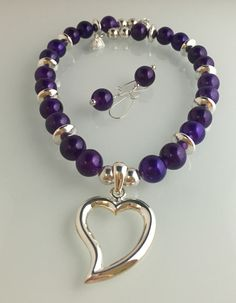 "Vibrant purple vintage beads, pewter with SS overlay beads, pendants& magnetic clasp, 19"" length."
