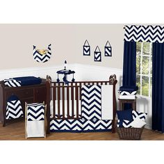 Navy Blue and White Chevron 11 Piece Crib Bedding Set has all that your little bundle of joy will need. Let the little one in your home settle down to sleep in this incredible nursery set. This unisex baby bedding set features a large chevron print. This collection uses the stylish colors of navy and white. The design uses brushed microfiber fabrics that are machine washable for easy care. This wonderful set will fit standard cribs and toddler beds. Dimensions: Crib Blanket: 45 inch x 36…