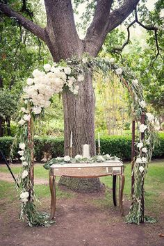 greenery and white flowers wedding arch