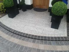 New step constructed using Marshalls eclipse granite with a bespoke border detail