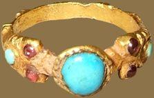 RENAISSANCE GEMSTONE RING  Italy?, 15th century  gold, turquoises and garnets  Bezel 6 x 5 x 4 mm.