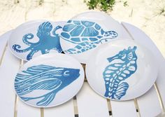 Sea Life Dinner Plates - set of 4 stoneware dinner plates featuring assorted sealife images in blue. Smaller appetizer/salad plates also available.