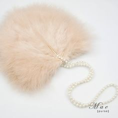 Swoon.............................Mae Feather Purse  http://www.brittenweddings.co.uk/shopbritten/wedding-purses/mae-in-blush-wedding-and-bridal-purse/
