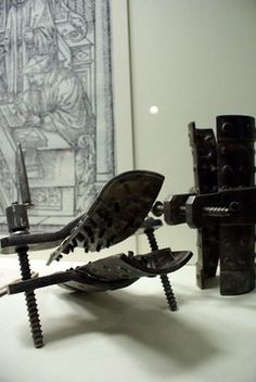 """If you think the Knee Splitter was murder on a person's lower limbs, wait til you know what the """"Boots"""" were about. This horrible piece of equipment was made up of wedges that fitted the legs from ankles to knees. Pure pain ensues when the torturer violently pounds the wedges with a large, heavy hammer, a process that is done repeatedly until flesh and bone are completely destroyed, with some victims even gushing marrow from their crushed legs."""