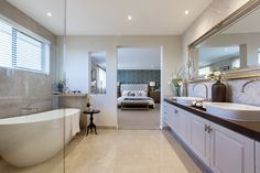 Traditional bathrooms are as popular today as they have ever been, thanks to the timeless appeal and luxurious aesthetic of the classical elements. Porter Davis, Bathroom Styling, Bathroom Ideas, Bathroom Lighting, Side Table Decor, Bathroom Cabinetry, Natural Stone Flooring, Storey Homes, Cabinet Decor