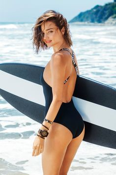 Surf's up as Miranda Kerr hits the beach for BONDS SWIM