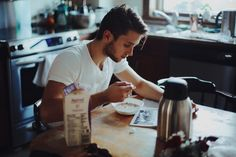 He came in to find that Garrett had snuck in and helped himself to breakfast. The young man sat casually in his chair reading the newspaper over his bowl of cheerios.