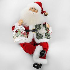 The Gift Personalization Santa from Karen Didion Originals brings the joy of Christmas into your home. The quality of this figurine is unmatched with its hand-painted face, glass inset eyes, real mohair beard, unique fabric, and detailed accessories.