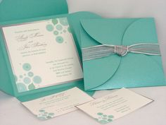 Photo By: SDezigns Weddings This beautiful Tiffany Blue and Silver invitation ensemble is perfect for the modern bride with a touch of elegance.  Find it on our Etsy shop:  sdezigns.etsy.comvendors: SDezigns Weddings