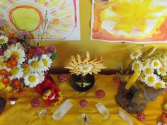 summer nature table - i like the use of yellow, sun paintings, warm colored flowers