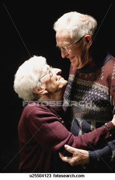 Stock Photo of Older couple look at each other