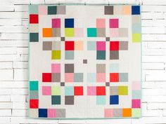 Stitch an intriguing blend of rich and subtle hues into your next quilt with this precut-friendly top.