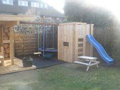 steigerhouten speelhuisje met glijbaan