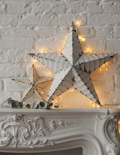 I need to paint my stars white and do lights like this for christmas!