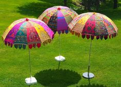 Indian garden parasols - made in Jaipur of colourful combinations of heavy vintage cotton panels.