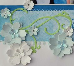 Fancy embellishment for scrapbook page