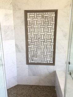 #Marble and #tilethatlookslikewood come together to make this gorgeous bathroom! #CalacattaUmber with our special order Calacatta Umber Basketweave are rounded out by our Hampton Grey Hex on the shower floor, Hampton Grey Ogee as the trim, and Club Grey on the bathroom floor! https://arizonatile.com/en/products/marble/calacatta-umber https://arizonatile.com/en/products/porcelain-and-ceramic/club https://arizonatile.com/en/products/mosaics/natural-stone-mosaics/hampton
