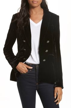 For fall 2017, Veronica Beard reimagines wardrobe favorites like this classic double-breasted jacket, here offered in plush black velvet with a minimalist latch closure.