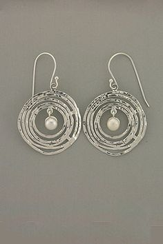 Whirl Pearl Earrings  Unique, hand made, sterling silver multi swirls earrings with a White Pearl hanging its center.Earrings: 1.75 inches long.  Price: $78.40  http://shop.zvuartisanjewelry.com/whirl-pearl-earrings-p2591.aspx