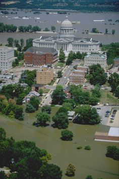 Jefferson City, MO flooded in 1993. An aerial view of floodwaters showing the extent of damage. A total of 534 counties in 9 states were declared for federal aid. 168,340 people registered for federal assistance. Photo by Andrea Booher/FEMA