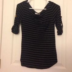 """Slouchy top Loose fitting slouchy top, scoop neck with side pocket on the left. A little longer than waist length (im 5'2""""). Buttoned up elbow length sleeves. Very soft material!                                                            only offers made through the offer button will be considered  Tops"""
