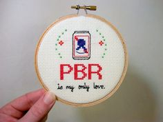 "PBR is my only love -- completed cross stitch in 4"" embroidery hoop with can of economy beer and flourishes"