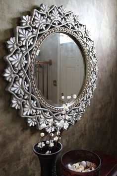 Pier 1 Round Shell Mother-of-pearl Mirror in an entryway