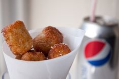 Tater Tots  serves 5, as a side dish  3 medium potatoes, finely grated and dried well  1/4 cup all purpose flour  1 teaspoon salt, plus more for serving  1/2 teaspoon black pepper  1/4 cup canola oil