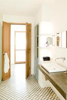 bathroom.  cute flooring, like the painted closet door, and nice sink.