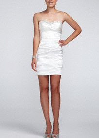 Sexy, modern, and over all a truly fabulous pick for any special occasion!  Strapless bodice features eye-catching glittering beaded detail.  All over ruched detail creates a stunning silhouette.  Stretch satin fabric is ultra-flattering and comfortable.  Fully lined. Back zip. Imported polyester/spandex blend. Professional spot clean.