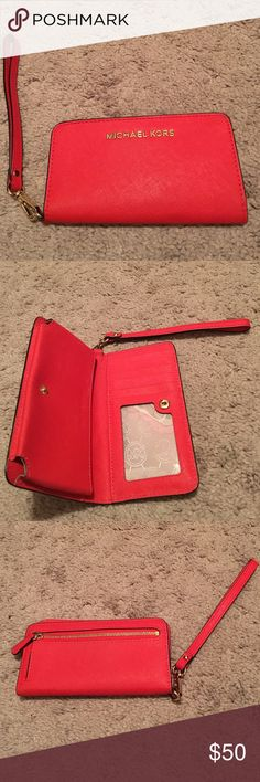 Michael Kors Smartphone Wristlet Gently used; in great condition. -Interior: 1 Phone Pocket, 1 Bill Compartment, 5 Card Holders, One ID Holder -Compatible With iPhone 6, Snap closure Michael Kors Bags Clutches & Wristlets