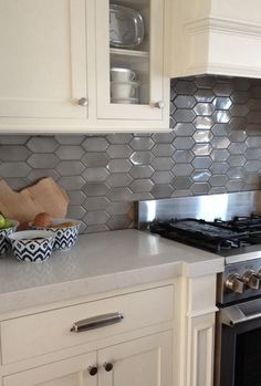 New color of beveled arabesque tile vento grey for the for Bellini kitchen cabinets
