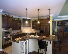 Large kitchen with breakfast bar on the center island.  European House Plan # 161127.