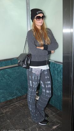 She's just like us: Paris Hilton indulged in a more relaxed approach to fashion as she act...