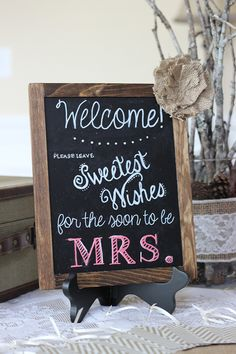 A great welcome sign and station set up for leaving notes for the bride-to-be