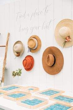 """From the editorial """"A Coastal Wedding Complete With the Cutest Steal-Worthy Sun Hat Escort Display."""" This has to be one of the cutest escort displays we've ever seen! We're sharing all the sweet details on stylemepretty.com!  Photography: @scottclarkphoto  #escortdisplay #weddingseatingchart #weddingdecor #weddingdetails #weddingideas"""