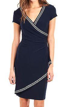 Hermoso vestido Joseph Ribkoff  azu marino con estoperoles, ideal para eventos formales.