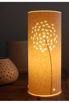 Hanna Nunn's paper cut lamps...just beautiful.