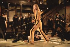 Kill Bill - The Bride wakens from a four-year coma. The child she carried in her womb is gone. Now she must wreak vengeance on the team of assassins who betrayed her - a team she was once part of. (for more quality movie inspiration visit highratedmovies.com)