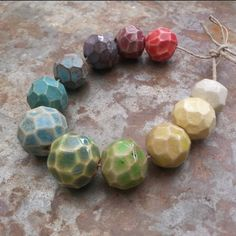 Love Gem… These hand formed and carved ceramic geode beads are glazed in a rainbow of sweet colors by Gaea Cannaday.