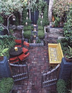 all paved garden with a few spots left for growing, love the gated idea as a private part of your own yard!