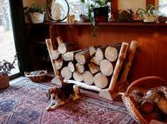 Artistic rustic furniture and home accessory item: a log holder / firewood storage rack created in Montana by artist and maker Joe Caneen.